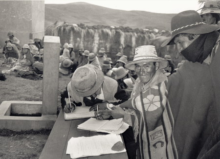 Black and white photo of the signing of a community agreement /  TAFOS-1990, Ayaviri, Puno